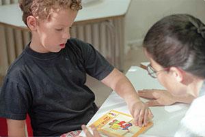 Padres y profesoras en la educación de un niño autista
